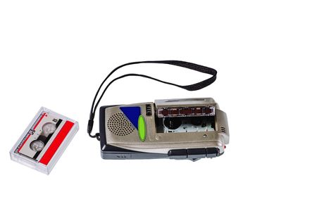 Close up view of old voice recorder and tape isolated. Old technology backgrounds.