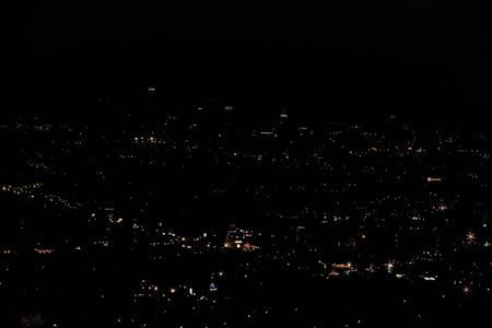 Pilot view over city with nightlights. Beautiful night backgrounds.