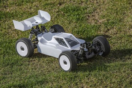 View of the R / C model car on green background. Toys with remote control. Free time Children and adults concept. Stok Fotoğraf