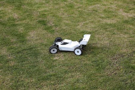 View of the R / C model car on green background. Toys with remote control. Free time Children and adults concept. Stok Fotoğraf - 123672258