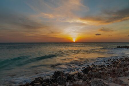 Amazing beauty colorful sunset on the Caribbean. Aruba island. Unforgettable view. Amazing background.