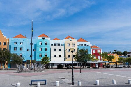 Beautiful view of colorful houses on blue sky background. Travel Tourism Trips concept. Colorful backgrounds texture. Willemstad. Curasao.