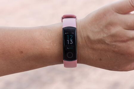 Close view of fitness tracker on wrist of female. Active living concept. Uppsala. Sweden 09092019.