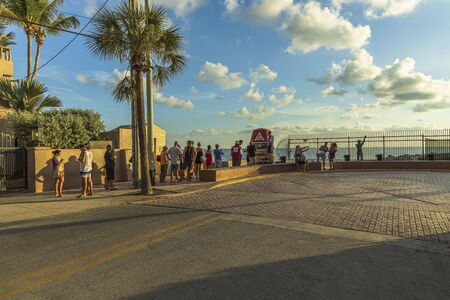 Tourists standing in line in order to take picture at famous tourist attraction Southernmost point. Key West. Florida USA 06092019