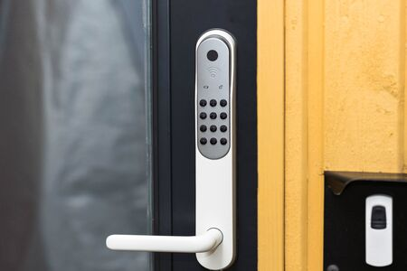 Close up view of an electric combination lock on a black door. Interior design. Beautiful backgrounds.