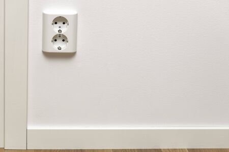 Close up view of white power socket on white wall. Electricity concept. 写真素材 - 132243388