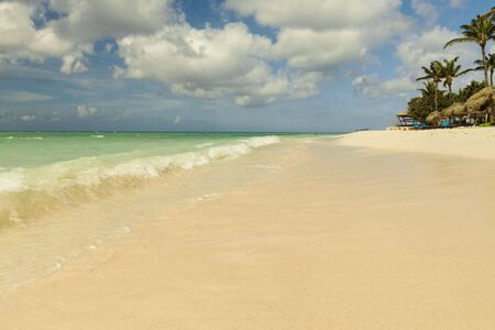 Amazing beauty white sand beach of Aruba Island. Turquoise sea water and blue sky. Beautiful background