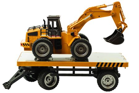 View of R  C model excavator and trailer on a white background. Free time Children and adults concept.