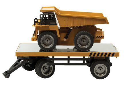 View of R / C model dump truck and trailer on a white background. Free time Children and adults concept.