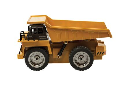 View of radio controlled model dump truck isolated on a white background. Free time. Children and adults concept.