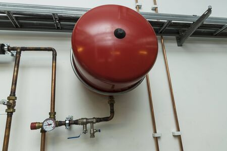Close up view of warming system element. Pressure indicator and join pipes. Building warming concept.