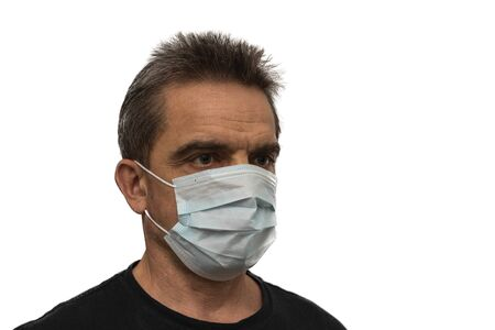 Close up view of man in white face mask. Influenza virus concept.