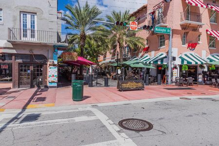 Beautiful view of outdoor cafe on one of Miami South Beach. Beautiful buildings and green trees on background. Eating out concept. Tourism concept. USA Miami South Beach. 24092019. 에디토리얼