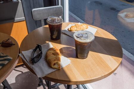 Beautiful close up view of round table with two coffee cups and pies.