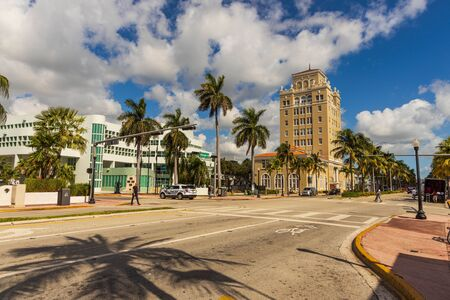 Landscape view of street of Miami. Colorful buildings on blue sky with white clouds background. USA Miami South Beach. 24092019.