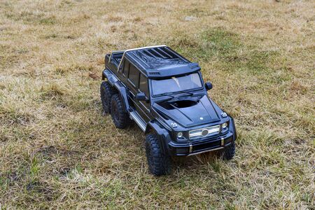 View of radio controlled model racing car on off-road background. Toys with remote control. Free time. Children and adults concept