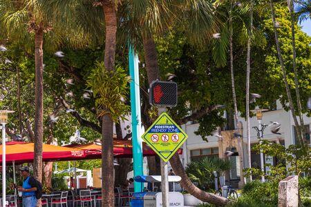 Pedestrian friendly zone on green trees background. Beautiful city landscape background. USA Miami Beach. 24092019.