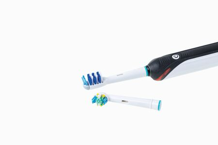Two kinds of head and toothbrush close up view isolated. Health care concept.