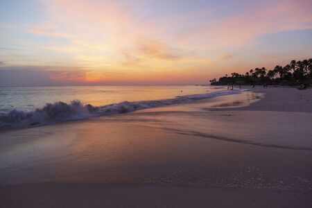 Gorgeous colorful view of sunset on Eagle Beach of Aruba Island. Caribbean. Unforgettable view. Beautiful nature landscape.