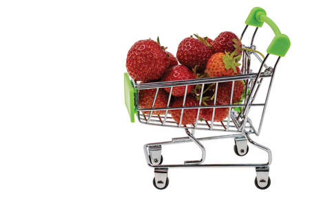Close up view of red strawberries in shopping cart on white background.