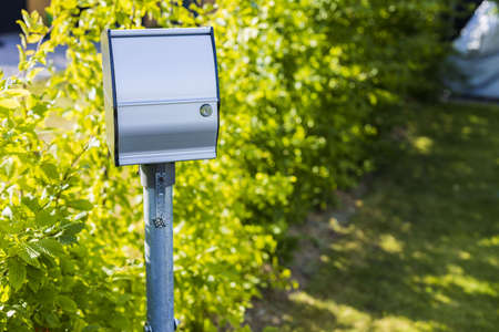 Close up view of outdoor power outlet isolated on green plants background. Technology concept.