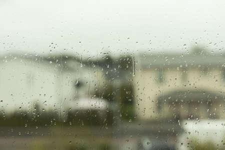 Beautiful view of raindrops running on window glass. Beautiful nature backgrounds. Archivio Fotografico