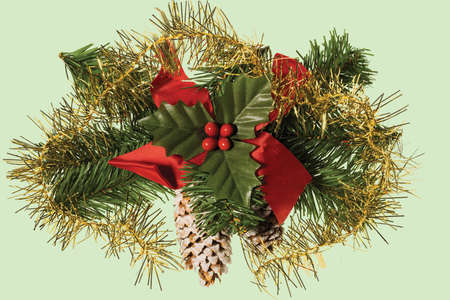 Close up view of Christmas decoration isolated on green background. Postcard. Beautiful Christmas backgrounds.