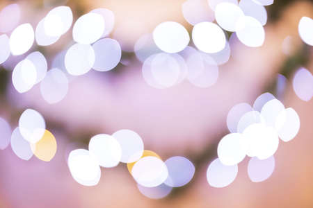 Beautiful view of colorful blurred abstract shiny Christmas lights.