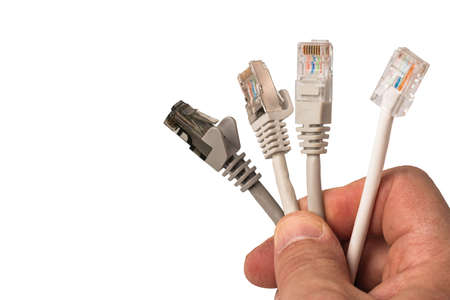 Close up view of cable network connection, internet communication and computer technology concept isolated on white background.