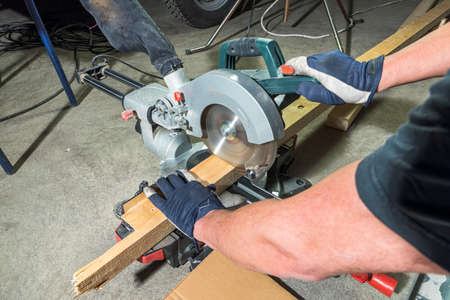 Close up view of male working on circular saw. Technology. Equipment concept.