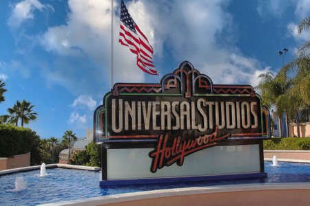 Universal Studios logo surrounded of blue fountain water. Beautiful backgrounds. USA. Los Angeles. 09.24.2019