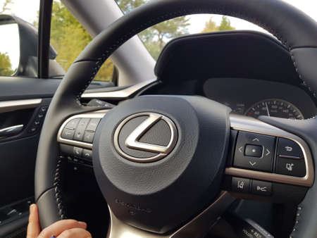 Close up view of female hand on steering wheel of Lexus RX car. Vehicle concept. Uppsala. Sweden. 10.25.2020. Editorial