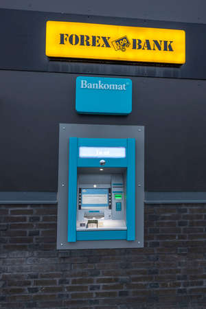 Close up view of outdoor Forex bank automat. Sweden. Europe. Uppsala. 01.13.2021.