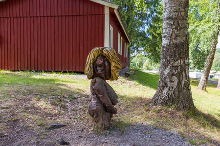 Close up view of wooden figure in outdoor park. Tourism and travel concept. Kolmarden, Sweden.