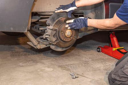 Close up view of how a man checks brake discs on a car. Transportation concept. Sweden.