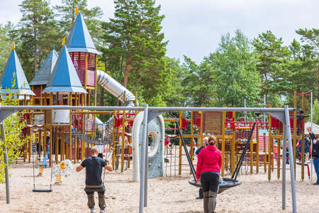 Parents with children are relaxing in a children's amusement park on a summer day. Europe. Kolmorden, Sweden. 09.28.2020. Editöryel