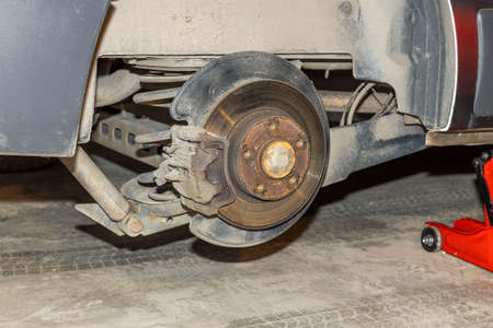 Close up view of man changing tire. Transportation concept. Sweden.