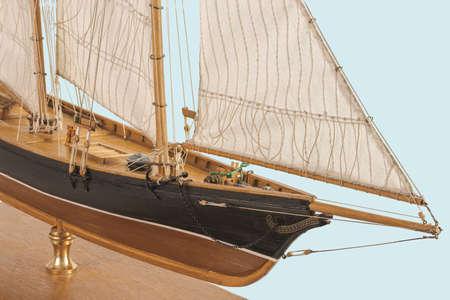 Handmade model sailing ship. Beautiful Handmade model sailboat of America New York 1851 isolated on blue background.