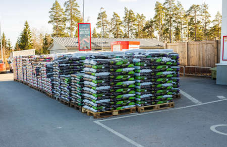 View of plastic bags with planting soil outside ICA local boutique. Europe. Sweden. Uppsala. 04.17.2021. Editöryel