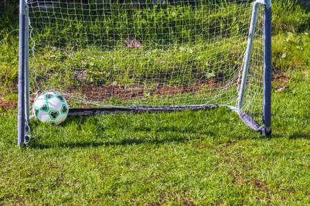Close up view of ball on football goal background. Sweden. Uppsala. 11/06/2021. Stok Fotoğraf