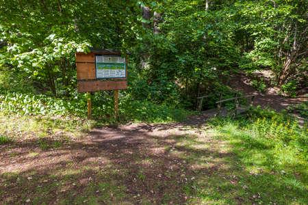 Beautiful nature landscape view background. Information desk in forest. Sweden.