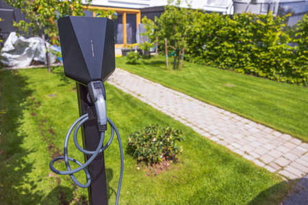 Close up view of charging station for electric car in front yard of townhouse. Sweden. Stok Fotoğraf