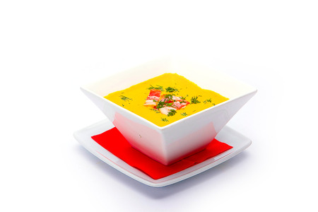 pumpkin soup: Bowl with pumpkin soup on white background.