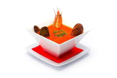 comprising: A soup comprising shellfish tomatoes and herbs.