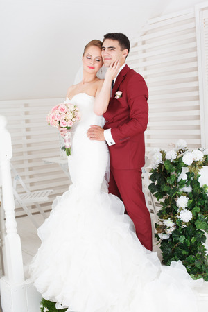 bride and groom side by side portrait. Stock Photo