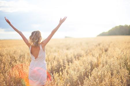 young woman in wheat field Standard-Bild