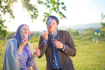 soap sud: Charming couple blowing bubbles Stock Photo