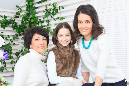 front stoop: Cute little girl, her mother and grandmother together on this portrait