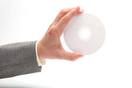 latex glove: Hand in latex glove holding compact disc