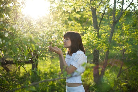 wellness environment: portrait of young woman in the garden Stock Photo